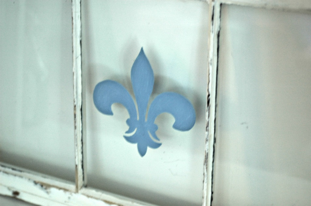Fleur-de-lis painted window