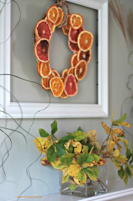 Yellow, orange and green fall mantel