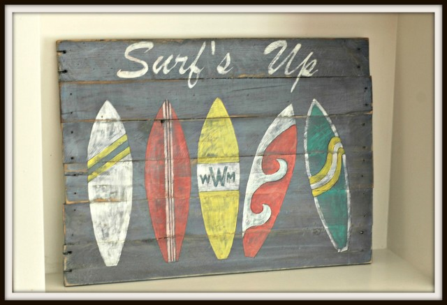 Handpainted surfs up sign with surfboards